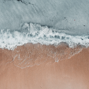 Aerial view of waves on beach